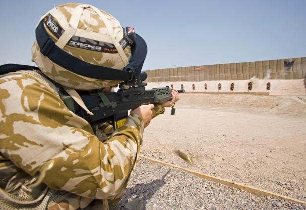 A British soldier aims his SA80 rifle on a shooting range at Basra, Iraq.
